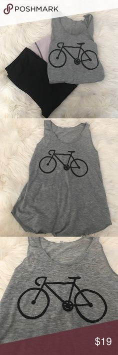 Adorable Bike  Tank Adorable Bike  Tank.  So cute with bicycle print.  Love this tee, simple and chic.  Versatile tank can be worn under a blazer, as a lounge/pj top or as a work out top.  Other styles available.  Ask me about bundling for discount :) Tops Tank Tops