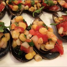 Steamed mussels with corn salsa with Rocoto sauce.  Super easy and super tasty!  Diced onion, corn, tomato, cilantro and rocoto paste.