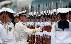 16 settembre 2013: marinai cinesi allineati a Pechino