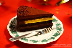 Passion Fruit, Mango and Chocolate Cake- chocolate genoise cake recipe spread with rich chocolate ganache layers and a surprise mango passion fruit curd layer in between.