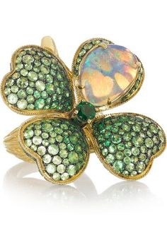 Lydia Courteille's fine jewelry This sparkling gold 'Four Leaf Clover' ring is centered around a stunning iridescent opal and set with green tsavorites - it's the ultimate good luck talisman. Garnet Jewelry, Opal Jewelry, Fine Jewelry, Tanzanite Jewelry, Tanzanite Ring, Jewelry Box, Jewelry Rings, Jewellery, Clover Ring