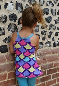 PDF pattern from Stitch Upon A Time. The Pixie is the girls version of the Titania.. 2 widths, 3 lengths, and 2 back styles, plus extras, drafted for sizes NB-12y. www.stitchuponatime.com