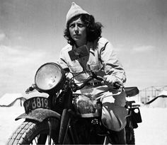 coordinator of the Hagana on her motorcycle by Zoltan Kluger (1948)
