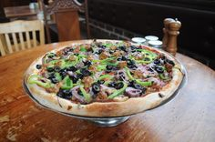 ANDOLINI'S COMBINATION:  We like this pizza so much, we put our name on it. Red sauce base, piled with pepperoni, genoa salami, mushrooms, red onions, bell peppers, black olives, ground beef, and of course, our house-made Italian sausage. If you're not sure what to order, you can't go wrong with the Ando combo.