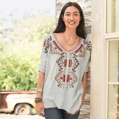 """MODERN TRIBE TOP--Our pieced, cotton slub top flows so beautifully with asymmetrical hem, rib trim, flattering seaming and tribal-inspired embroidery. Machine wash. Imported. Exclusive. Sizes XS (2), S (4 to 6), M (8 to 10), L (12 to 14), XL (16). Front approx. 28""""L."""