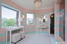 A $10,950,000 mansion will get you a very nice pink bathroom with chandelier.