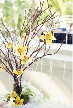 Decorating with branches: orchids or flowers of our choice add some bling! Easy, can have done ahead of time