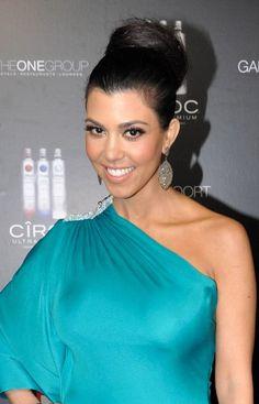 Kourtney Kardashians sleek, bun hairstyle