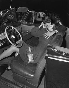 A couple kissing in the front seat of a convertible car at a drive-in. A couple kissing in the front seat of a convertible car at a drive-in movie theater, The man in the next car ignores the couple, resting his elbow on the window. Vintage Kiss, Vintage Couples, Vintage Romance, Vintage Love, Old Fashioned Love, Drive In Movie Theater, Teenage Love, Mode Vintage, Vintage Photographs