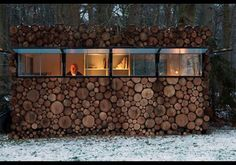 Wood House, Hilversum, Netherlands  This mini-dwelling is disguised as a pile of wood that's been stacked for the winter. In actuality, the building is a pre-fab structure made of steel and plastic. The log-like appearance was achieved by applying a wood veneer. When its windows are popped open, light pours in, making it perfect for a recording and practice studio for musician Hans Liberg.   (Courtesy of Thomas Mayer)