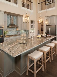 Like how chic this kitchen is with two toned cabinets, beautiful color granite, dark hard wood floors and light colored rustic bar stool