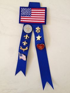 Eagle Scout Court of Honor mother's pin. Will make it easier for son to put Mother's Eagle pin on. Made from scout flag patch, blue gross grain ribbon, and safety pin (on back). Also great way to keep all mother's pins together.