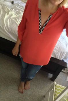 Love this style of top.  The color is great and the small detail at the neckline is perfect