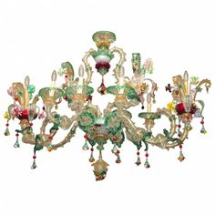 A large and extravagant eight light glass chandelier, with leafy, scrolling arms supporting bouquets of highly detailed and multi-colored flowers, the arms laden with hanging berries and clusters of small flowers.