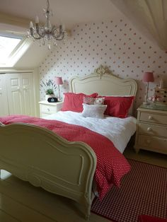 wallpapered feature wall behind bed - could try this in small bedroom with sloping ceiling