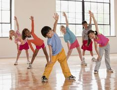 Dynamic stretching for kids - group of children