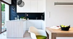 We love this light & bright kitchen. The benchtop looks like it is limed wood and the chalk painted splashback creates a sense of depth needed.
