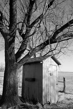 Ye olde outhouse, in glorious black and white.