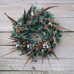 Large wild garden style wreath with pheasant feathers, pine cones, allium, nigella and teasle dried seed heads Christmas Door Wreaths, Christmas Flowers, Holiday Wreaths, Rustic Christmas, Christmas Decorations, Floral Decorations, Feather Wreath, Antler Wreath, Feather Crafts
