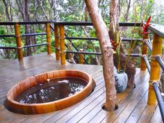 A treehouse home with a hot tub in Hawaii.  Awesome!