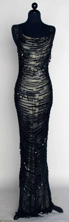 BLACK BEADED EVENING GOWN, LATE 20TH C Sheath w/ sequins & beads all-over.Property of dancer Lynne Clifton-Allen. Front