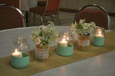 Love the centerpiece idea...except I want to flowers in the mason jar w/ burlap and lace around it. Then have the candles on the table around the mason jar. All of which will be in a little wooden box