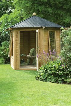 Henley Summerhouse | The Henley Summerhouse has two large bottom opening windows. The black shingle roof not only gives a stylish finish but also provides protection from the elements. #summerhouses