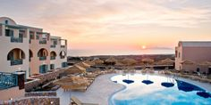 #JSSunrise-Astro Palace Hotel & Suites: The Astro Palace debuted in Santorini last year, with one of the best pools on the island.