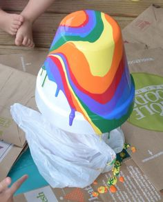 We love a craft that looks impressive and difficult but is actually oh-so-easy. That's the case with this rainbow pour-paint flower pot from In Lieu of Preschool. To get the psychedelic result, the youngsters will get to squeeze and play with paint–always a kid fave! Afterwards, you can get started planting summer flowers or use the pots for pencil holders or teacher gifts. #DIY