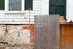 image of old bricked wall and window. - Close-up shot of old bricked wall and window.