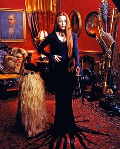 aikainkauna:  newrulesnewlife:  Gillian Anderson as Morticia Addams  I am tagging this, aikainkauna, because I thought it was one of her selfies for a second, I would bet good money that she has that outfit, I used to have this pic saved somewhere when it came out. As a life goal for a late-teens me. I have now reached that life goal, hairwise at least. Cousin It, I mean.