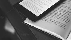 Check out Paper Book vs eBook by Shots By RC on Creative Market