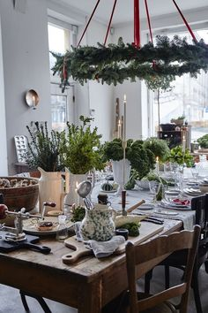 I love a ring of evergreens over the Christmas table