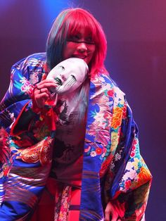Asuka...NXT/WWE Champion...2016. (She wears her scary Japanese mask to the ring.).