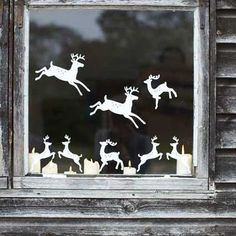 Tons of cute holiday window decorations. These reindeer are great though!