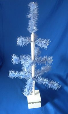 Feather Christmas Trees: How to Make a Feather Tree - good tutorial
