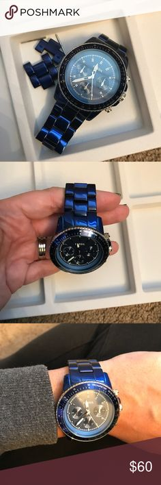Fossil blue boyfriend watch Good condition, you can see in the picture the blue came off a bit underneath but it's hard to notice when your wearing it. Comes with extra links. Needs a new battery. Fossil Accessories Watches