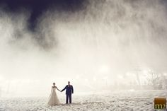 Portrait of Bride & Groom.  Snow in background is from a snow machine!  Sooo cold.