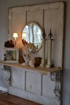 Salvaged door turned mantel...gorgeous.