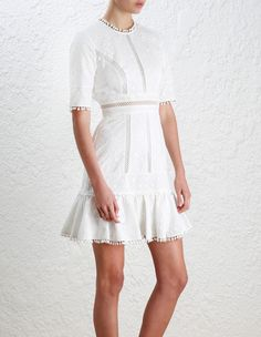Zimmermann Caravan Embroidered Flip Dress COMING SOON. Model Image.  Our model is 5 9 5 and is wearing a size 0
