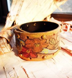 Bohemian Flower Leather Hand Painted Cuff Snap Bracelet Boho Hippie Tribal Bangle Brown Mexican Floral Patterened. $29.99, via Etsy.
