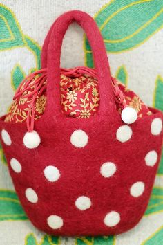 """Enjoy our fun and whimsical hand - felted wool coin bags and purses to make your lil fashionista smile. *Perfect gift for young girls *With inside lining *Made by artisan women in Nepal *100% natural hand felted wool *Measurements: Handle: 12-13"""", purse size: 10"""" x 7.5"""""""