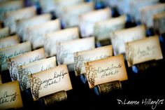 Gorgeous-antique-looking-calligraphy-escort-cards-set-in-wine-corks.full