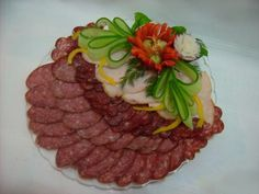 Cut vegetables on a festive table at home. Cutting sausage and … - Wurst Meat Platter, Food Platters, Food Design, Best Party Food, Party Trays, Food Garnishes, Veggie Tray, Food Displays, Food Decoration