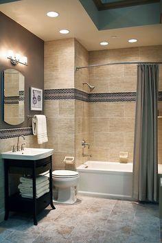 contrasting dark border tiles on the walls