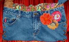 recycled Mudd jeans made into a cute purse - lined with paisley & leather laces holds it together