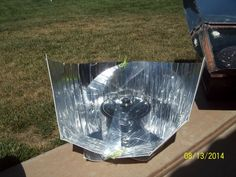 The Haines Solar Cooker, compact, portable and very efficient solar panel cooker. available from: http://www.solarcooker-at-cantinawest.com