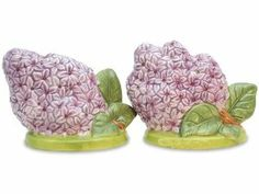 """Flower Garden Lilac Blossom Salt & Pepper Shakers S/P by Downeast Concepts. $15.88. Approximately 5"""" side by side. Hand painted ceramic. This Lilac Blossom set of salt and pepper shakers is sure to brighten up your kitchen table, shelves or countertop. Cooks and collectors will delight in owning this fun loving set. A welcome gift to give or receive, helping to make special memories.. Save 16%!"""