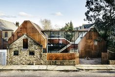 Rising up behind a 19th-century stable wall, the Kew House does a standout job of joining the old with the new. The home is comprised of two prefabricated volumes that are joined by glass-enclosed stairways and platforms. Weathered steel cladding...
