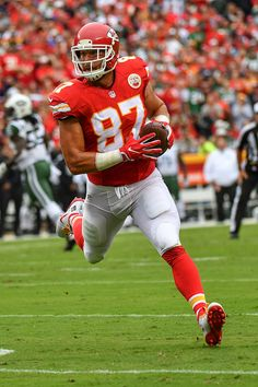Tight end Travis Kelce of the Kansas City Chiefs runs after a reception  against the New York Jets at Arrowhead Stadium during the game on September. 08b52ed39fa